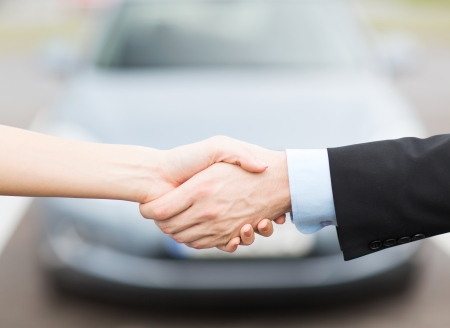 transportation, business, shopping and ownership concept - customer and salesman shaking hands outside Imagens - 22185115