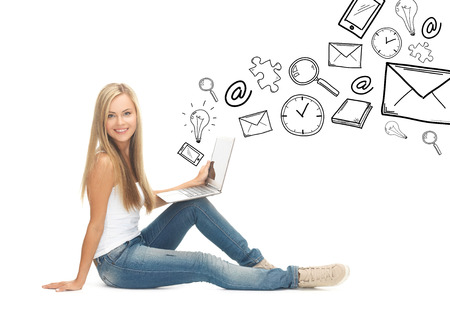 education and school concept - student girl with laptop computer photo