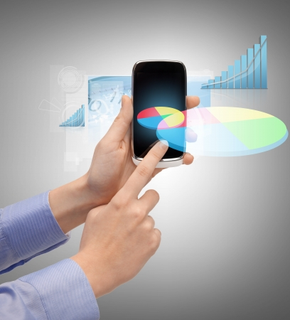 digi: technology, internet and application concept - hand holding smartphone with virtual chart Stock Photo