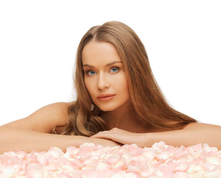 balsam: health and beauty concept - beautiful woman with rose petals