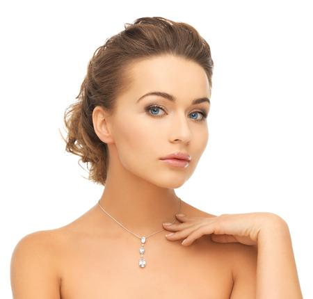 pendant: beauty and jewelry concept - woman wearing shiny diamond pendant Stock Photo
