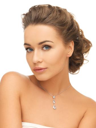 beautiful neck: beauty and jewelry concept - woman wearing shiny diamond pendant Stock Photo