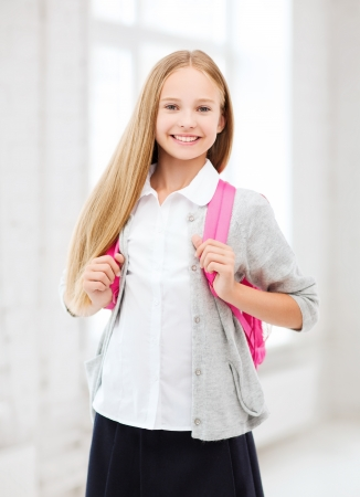 education and school concept - happy and smiling teenage girl with school bag