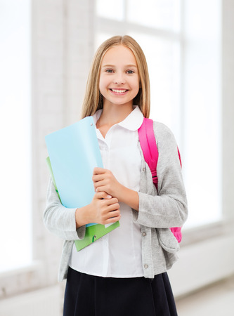 new school year: education and school concept - happy and smiling teenage girl