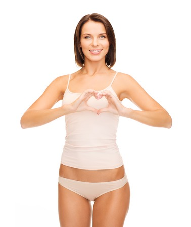 breast girl: health, charity and beauty concept - beautiful woman in cotton underwear forming heart shape Stock Photo