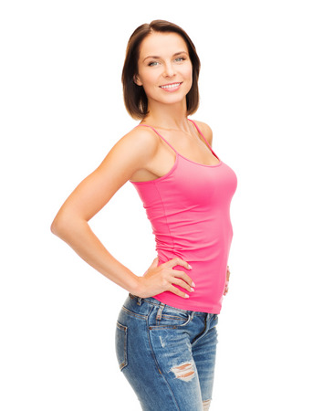 tank top design concept - smiling woman in blank pink tank top photo