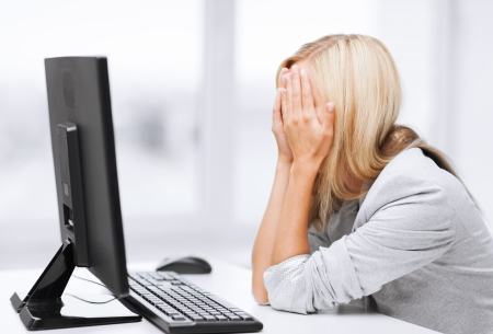 business, office, school and education concept - stressed businesswoman with computer at work