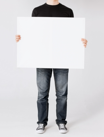 business and advertisement concept - man showing white blank board Stock Photo - 22185483