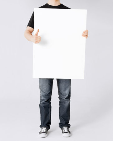 business and advertisement concept - man showing white blank board and thumbs up Stock Photo - 22185484