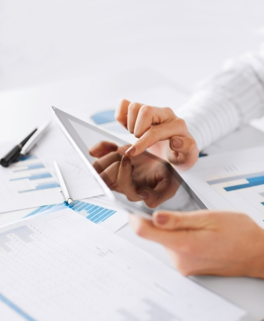 business, office, school and education concept - woman with tablet pc and chart papers photo
