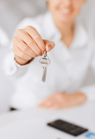 business, banking, real estate concept - woman hand holding house keys Stock Photo - 22185554