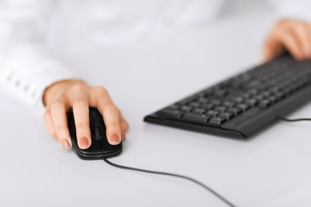 business, office, school and education concept - woman hands with keyboard and mouse photo