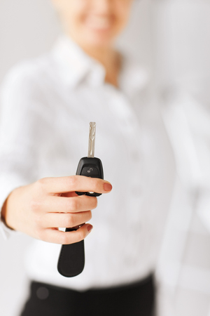 business, banking, vehicle, rental, automotive concept - woman hand holding car key Stock Photo - 22185594