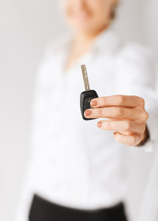 business, banking, vehicle, rental, automotive concept - woman hand holding car key Stock Photo - 22185595