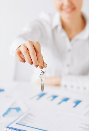 business, banking, real estate concept - woman hand holding house keys Stock Photo - 22185632