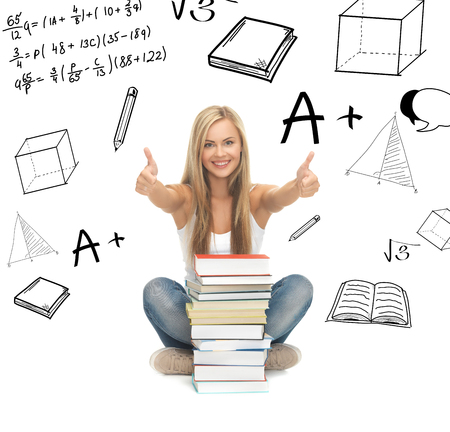 educational material: education and school concept - picture of smiling student with stack of books Stock Photo