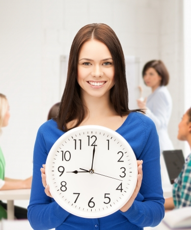 career timing: education and time management concept - attractive student showing clock