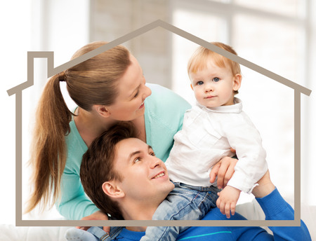 dream home: home, real estate and family concept - family with child and dream house Stock Photo