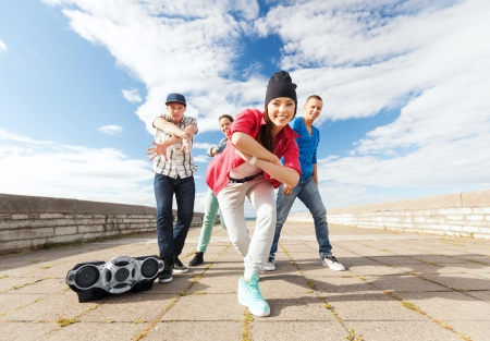 funky music: sport, dancing and urban culture concept - group of teenagers dancing