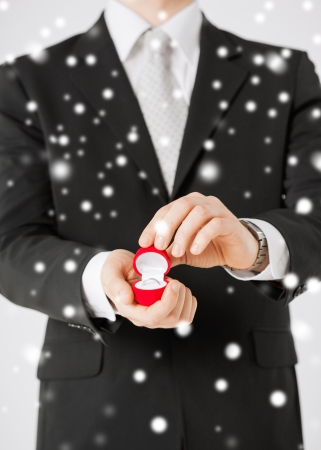 picture of man with gift box and wedding ring Stock Photo - 22380144