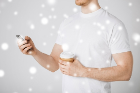 man with smartphone and take away coffee cup Stock Photo - 22380145