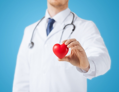 healthcare and medical concept - male doctor with heart photo