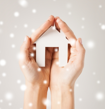 closeup piСЃture of woman hands holding paper house photo