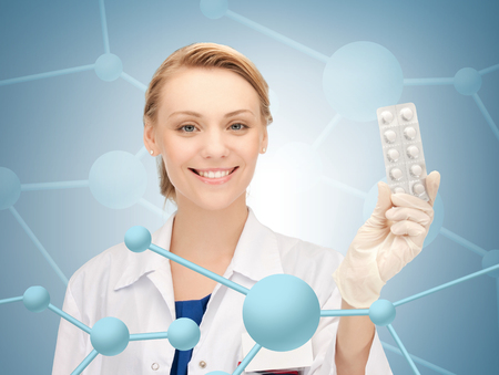 healthcare, hospital, research, science and medical concept - attractive female doctor with pills photo