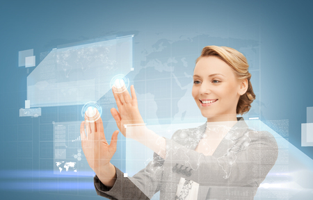 future technology and internet concept - attractive woman working with virtual screen photo