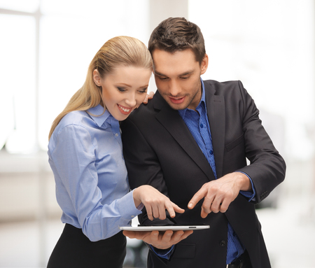 buisness woman: office, buisness, education, technology concept - man and woman with tablet pc