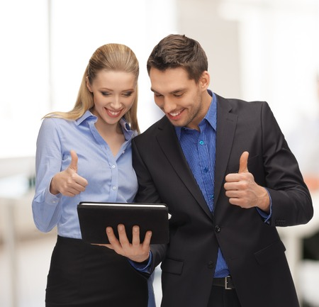 buisness: office, buisness, education, technology concept - man and woman with tablet pc