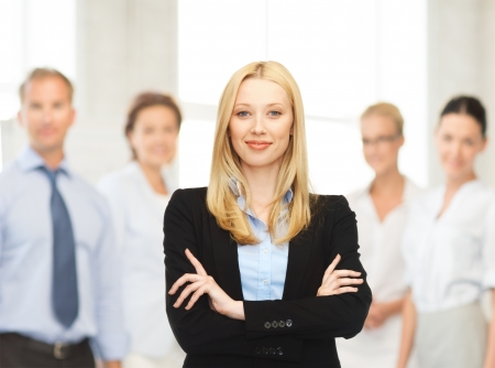 buisness: office, buisness, teamwork concept - friendly young smiling businesswoman