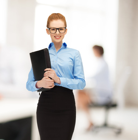 buisness woman: office, buisness, education concept - young smiling woman with folder Stock Photo