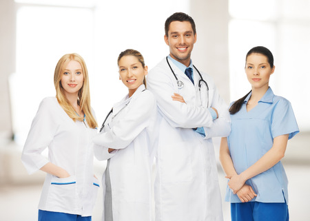 physiotherapists: healthcare, hospital and medical concept - young team or group of doctors