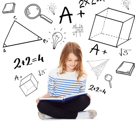 homework student: education and school concept - little student girl studying and reading book