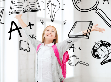 education and school concept - happy and smiling teenage girl with raised hands Stock Photo