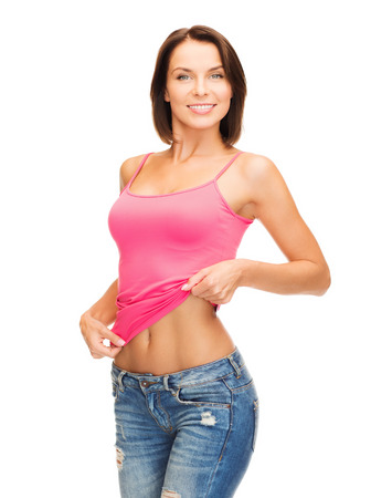 abs: health, diet and beauty concept - happy woman taking off blank pink tank top or showing abs