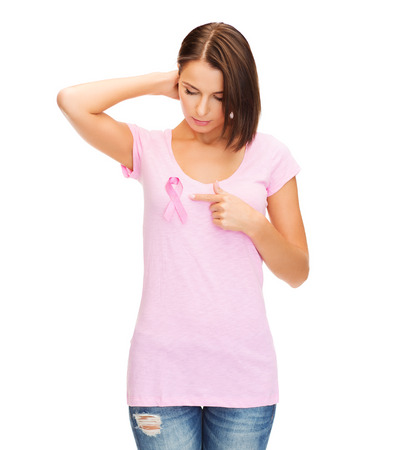nice breast: healthcare, medicine concept - woman with pink breast cancer awareness ribbon Stock Photo