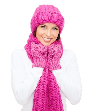 winter, people, happiness concept - woman in hat, muffler and mittens Stock Photo