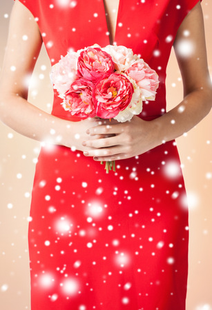 bridal, floral, holidays concept - woman hands with bouquet of flowers photo