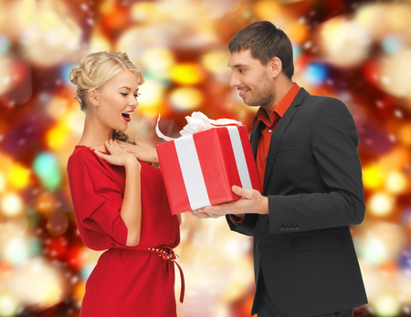 winter, holidays, christmas concept - man and woman with gift box Stock Photo - 22380979