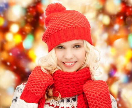teenage girl happy: winter, holidays, christmas concept - beautiful teenage girl in hat, muffler and mittens