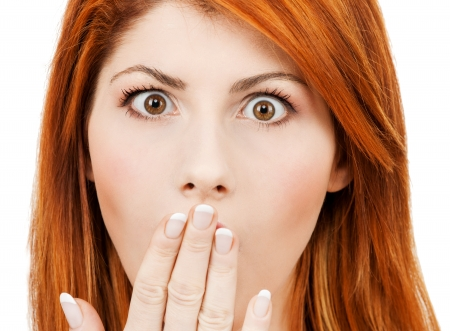 beautiful redhead: picture of amazed woman with hand over mouth