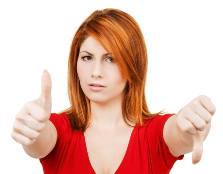 business concept - businesswoman with thumbs up and down photo