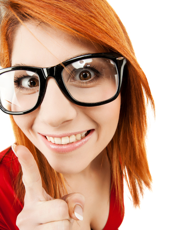 health, beauty, business concept - woman in glasses with finger up photo