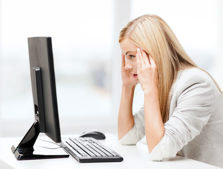 frustrated student: business, office, school and education concept - stressed businesswoman with computer at work