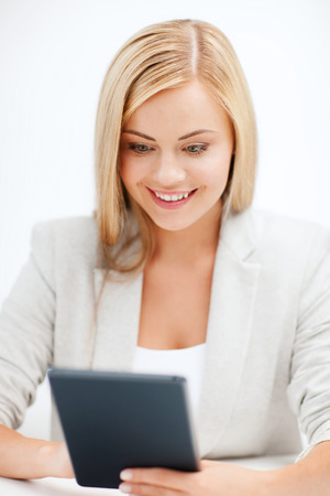 business and education concept - smiling student girl with tablet pc or e-book reader photo