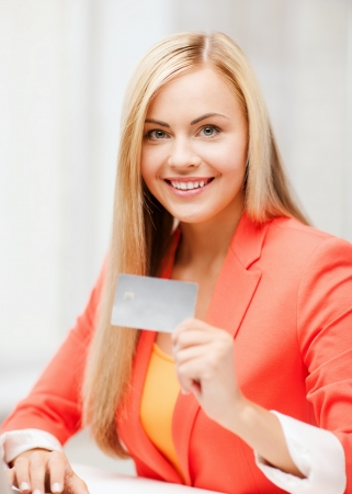 business and internet concept - smiling businesswoman with laptop using credit card photo