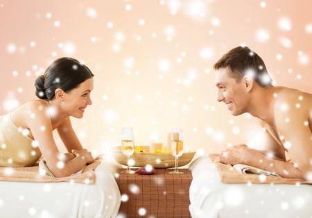 health and beauty, honeymoon and vacation concept - couple in spa salon drinking champagne photo