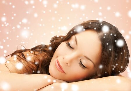 health and beauty concept - beautiful woman with long eyelashes in spa photo